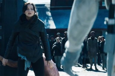 Katniss steps in between the rebel being whipped and the Peacekeeper.  What a brave girl!