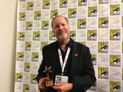 Anderson winning a Scribe Award at SDCC