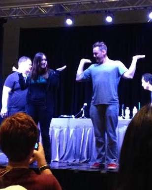 Nicholas Brendon showing a Whedonite how to Snoopy Dance on stage at Comicpalooza 2014.