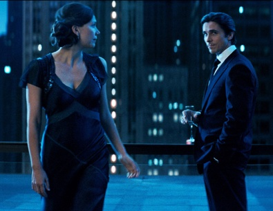 Bruce played by Christian Bale and Rachel Dawes Played by Maggie Gyllenhaal in The Dark Knight.