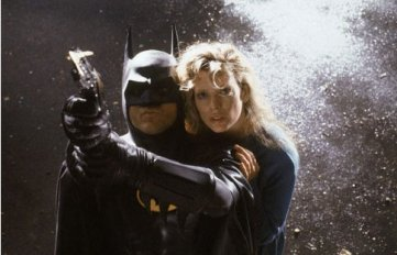 Batman (played by Michael Keaton) and Vicki Vale (played by Kim Basinger) get ready to fly in Tim Burton's Batman.