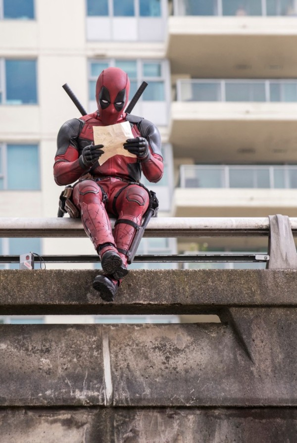 Deadpool (Ryan Reynolds) gets some reading done between crime fighting. Photo Credit: David Dolsen TM & © 2015 Marvel & Subs.  TM and © 2015 Twentieth Century Fox Film Corporation.  All rights reserved.  Not for sale or duplication.