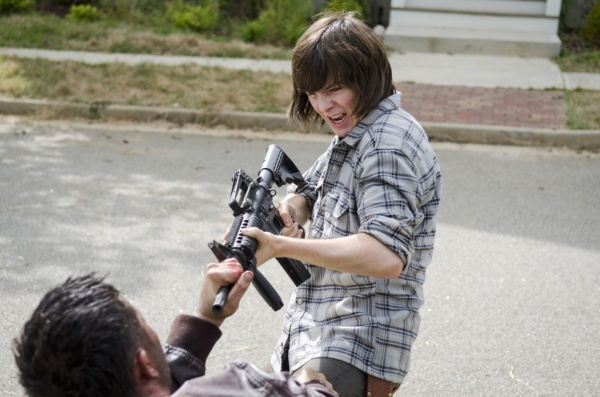 Alec Rayme as Shaved Head Wolf  and Chandler Riggs as Carl Grimes - The Walking Dead _ Season 6, Episode 2 - Photo Credit: Gene Page/AMC